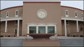 The capitol collection capitol information page new mexico the structure of todays capitol dedicated in 1966 is a modified form of the indian sun symbol or zia which appears on the state flag publicscrutiny Choice Image